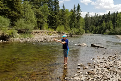 Connor fly fishing on Conejos River